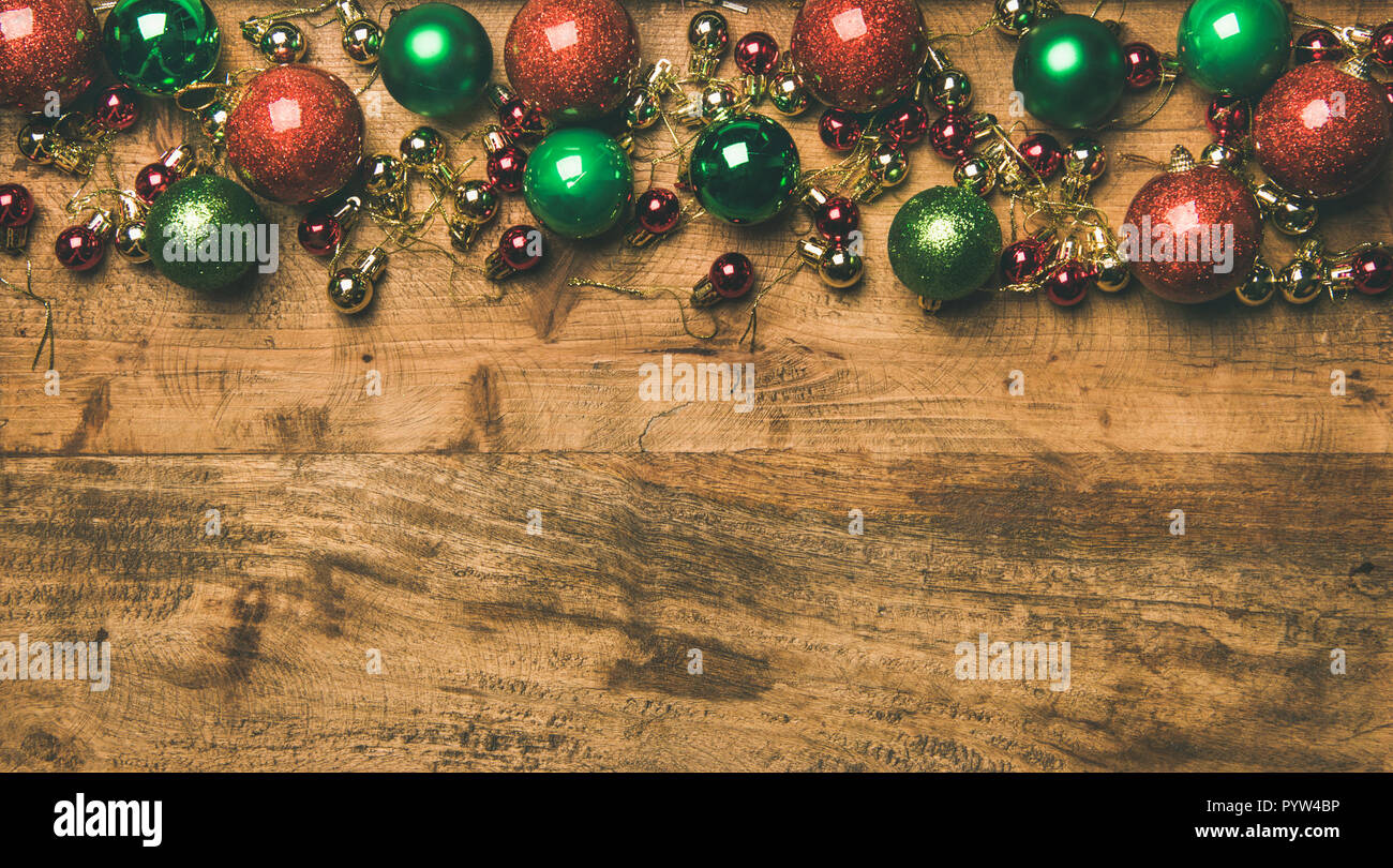 christmas new year holiday background texture wallpaper flat lay of colorful green red golden christmas tree decoration balls on wooden backgrou