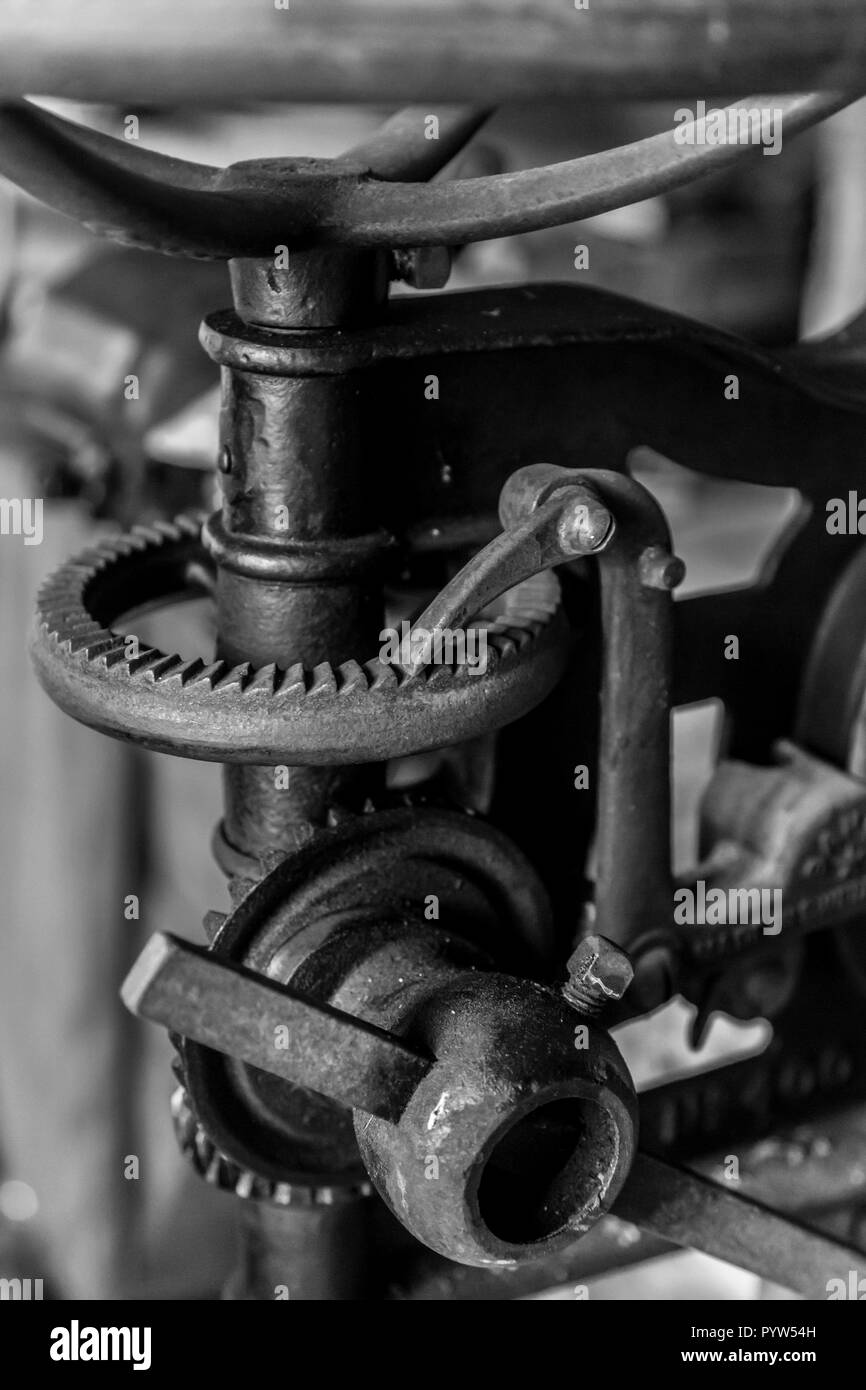 Antique manual drill press in a workshop at an old Swedish farm in northern Sweden - Stock Image