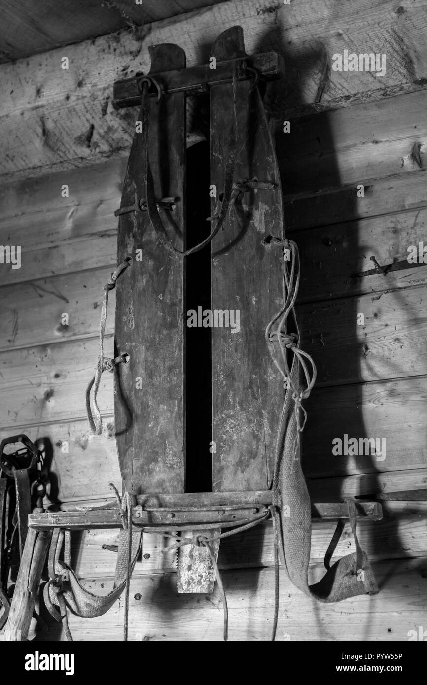 Antique sled hanging on wall in an old Swedish farm in northern Sweden - Stock Image