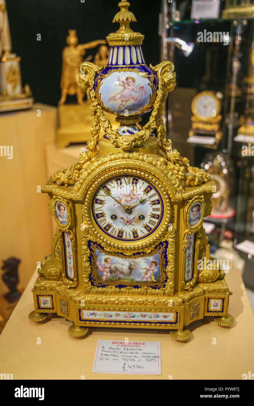 London UK 30 October 2018 Now in its 28th year the Winter and Art Fair Richard Price and associates offering outstanding quality,with some exquisite example  of antique clocks French Porcelain and ormolu circa 1875 on offer for £4950.00 Credit: Paul Quezada-Neiman/Alamy Live News - Stock Image