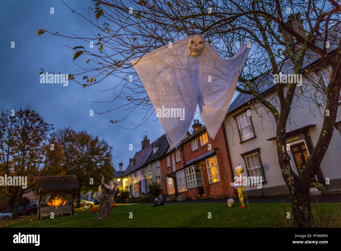 Scary halloween decorations in the dark at dusk on the