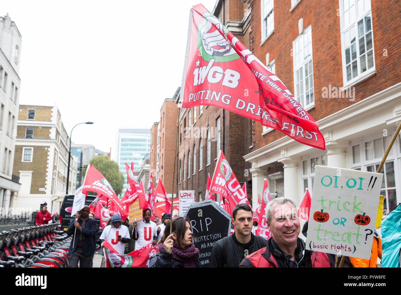 London, UK. 30th October, 2018. Members and supporters of the Independent Workers of Great Britain (IWGB) trade union march together with other precarious workers from the offices of Transport for London to the University of London via the Court of Appeal in support of Uber drivers who are seeking employment rights. The Court of Appeal will today hear an appeal by Uber against a ruling that its drivers are employees rather than self-employed workers. Credit: Mark Kerrison/Alamy Live News - Stock Image