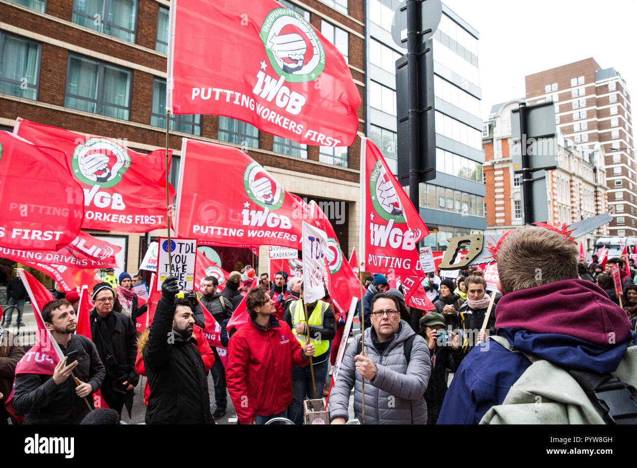 London, UK. 30th October, 2018. Mags Dewhurst, Vice-President of the Independent Workers of Great Britain (IWGB) trade union addresses members, supporters and precarious workers after a march from the offices of Transport for London to the University of London via the Court of Appeal in support of Uber drivers who are seeking employment rights. The Court of Appeal will today hear an appeal by Uber against a ruling that its drivers are employees rather than self-employed workers. Credit: Mark Kerrison/Alamy Live News - Stock Image