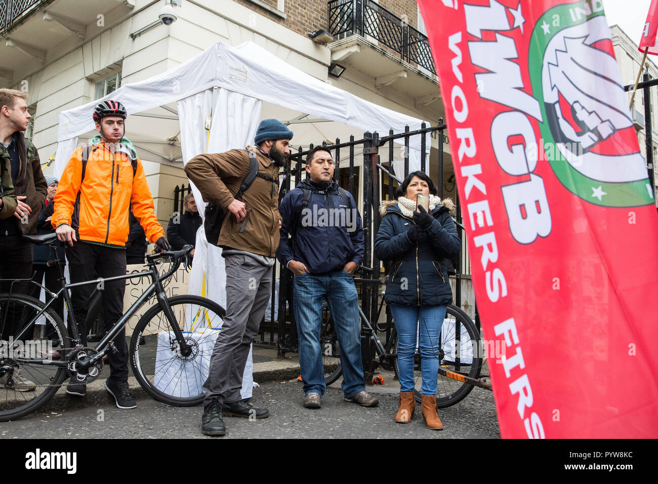 London, UK. 30th October, 2018. An Independent Workers of Great Britain (IWGB) trade union member addresses supporters and other fellow precarious workers after a march from the offices of Transport for London to the University of London via the Court of Appeal in support of Uber drivers who are seeking employment rights. The Court of Appeal will today hear an appeal by Uber against a ruling that its drivers are employees rather than self-employed workers. Credit: Mark Kerrison/Alamy Live News - Stock Image