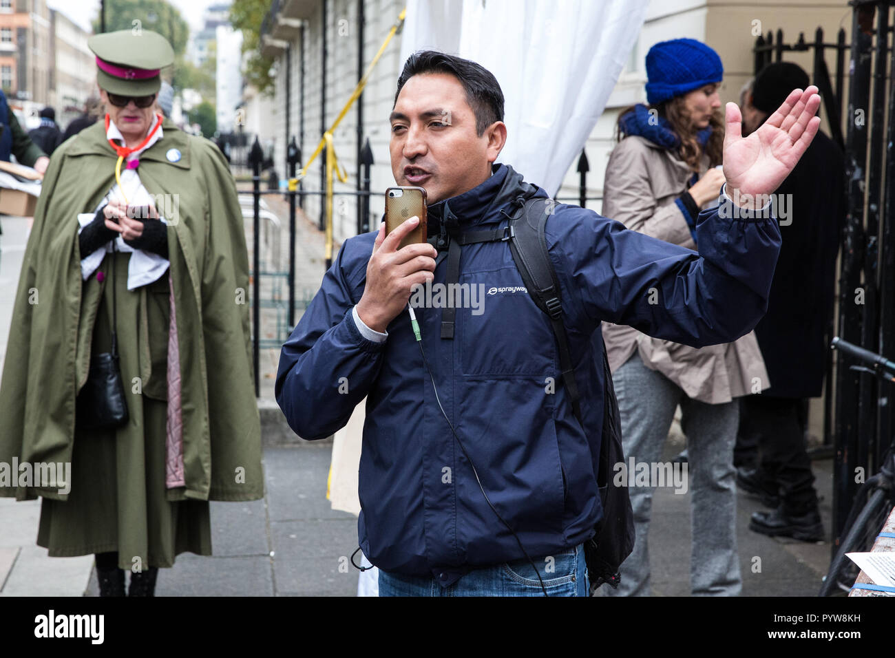 London, UK. 30th October, 2018. Henry Chango-Lopez, President of the Independent Workers of Great Britain (IWGB) trade union addresses members, supporters and precarious workers after a march from the offices of Transport for London to the University of London via the Court of Appeal in support of Uber drivers who are seeking employment rights. The Court of Appeal will today hear an appeal by Uber against a ruling that its drivers are employees rather than self-employed workers. Credit: Mark Kerrison/Alamy Live News - Stock Image