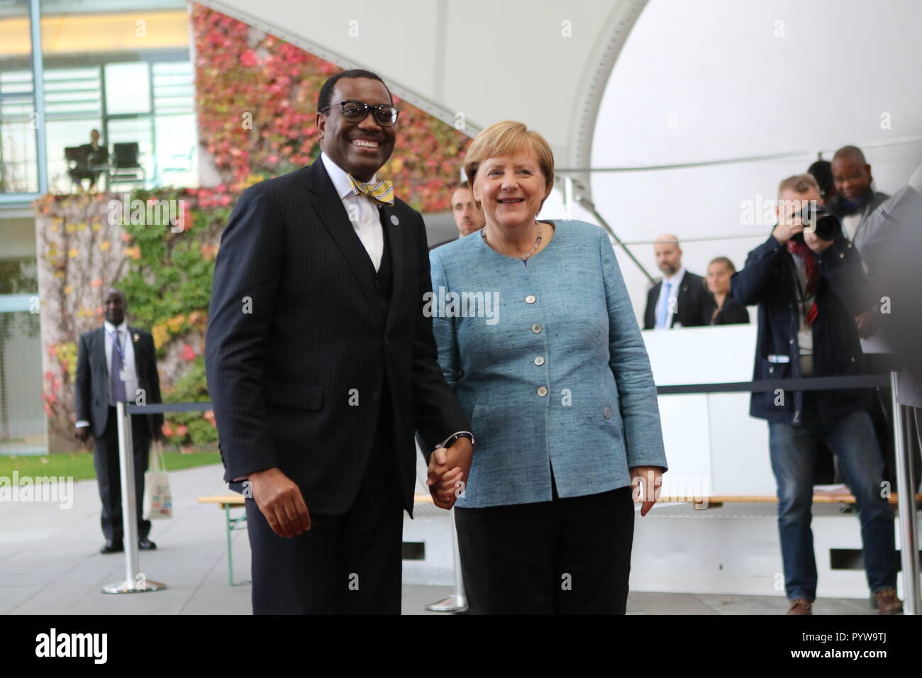 Berlin, Germany. 30th October, 2018. Chancellor Angela Merkel and Akinwumi Aydeji Adesina, African Development Bank at the reception in the courtyard of the Federal Chancellery.The meeting will take place within the framework of Compact with Africa. Credit: SAO Struck/Alamy Live News - Stock Image