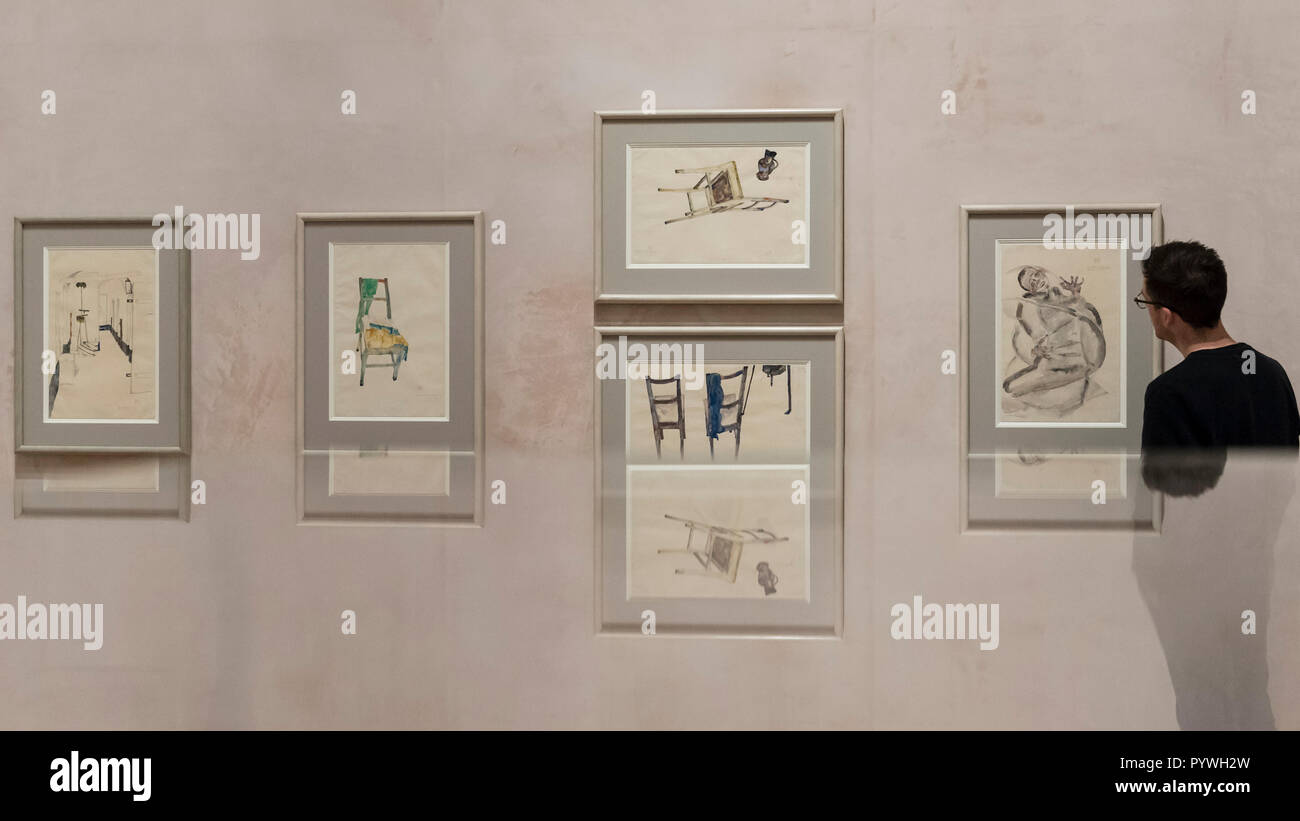 London, UK.  31 October 2018.  A visitor views works from the Prison Series, all by Egon Schiele. Preview of 'Klimt / Schiele:  Drawings from the Albertina Museum,Vienna' exhibition at the Royal Academy.  Over 100 works on paper are on display in an exhibition which marks the centenary of the deaths of the two most celebrated and pioneering figures of early twentieth-century art.  The show runs 4 November to 3 February 2019. Credit: Stephen Chung / Alamy Live News - Stock Image