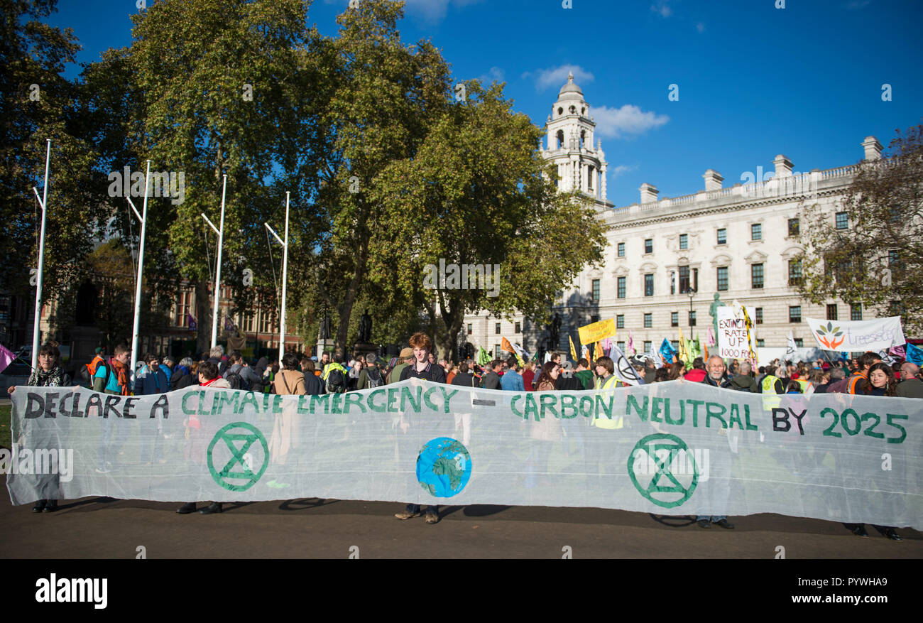 Parliament Square, London, UK. 31 October, 2018. Extinction Rebellion, a new pressure group, is calling for civil disobedience in the UK in November to draw attention to the climate change emergency facing the planet. They call a Declaration of Rebellion at Parliament Square on 31 October 2018. Credit: Malcolm Park/Alamy Live News. - Stock Image
