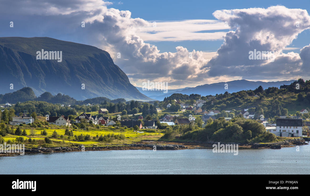 Norwegian village in fjord landscape on sunny day in august Norway - Stock Image