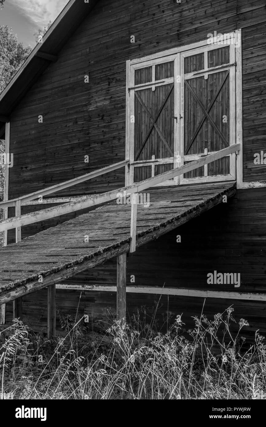 Barn ramp to hay storage loft at an old Swedish farm in northern Sweden - Stock Image