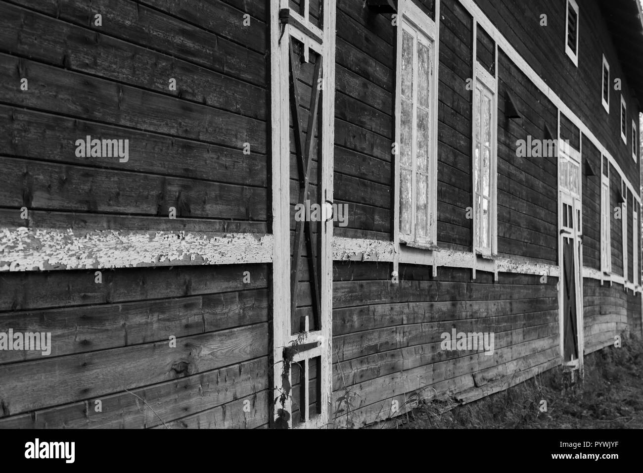Barn door and window in an old Swedish farm in northern Sweden - Stock Image