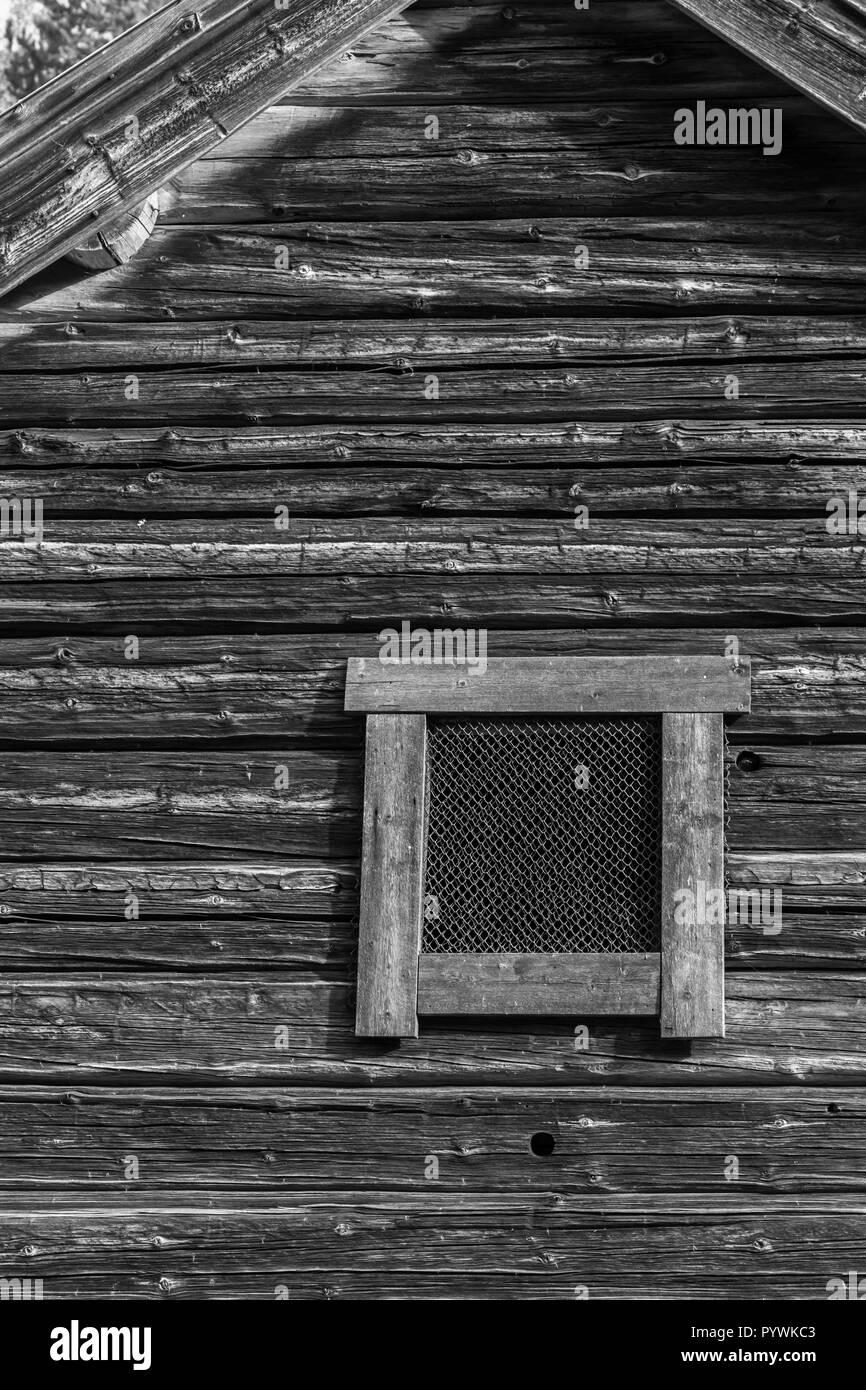 Rustic barn window in an old Swedish farm in northern Sweden - Stock Image
