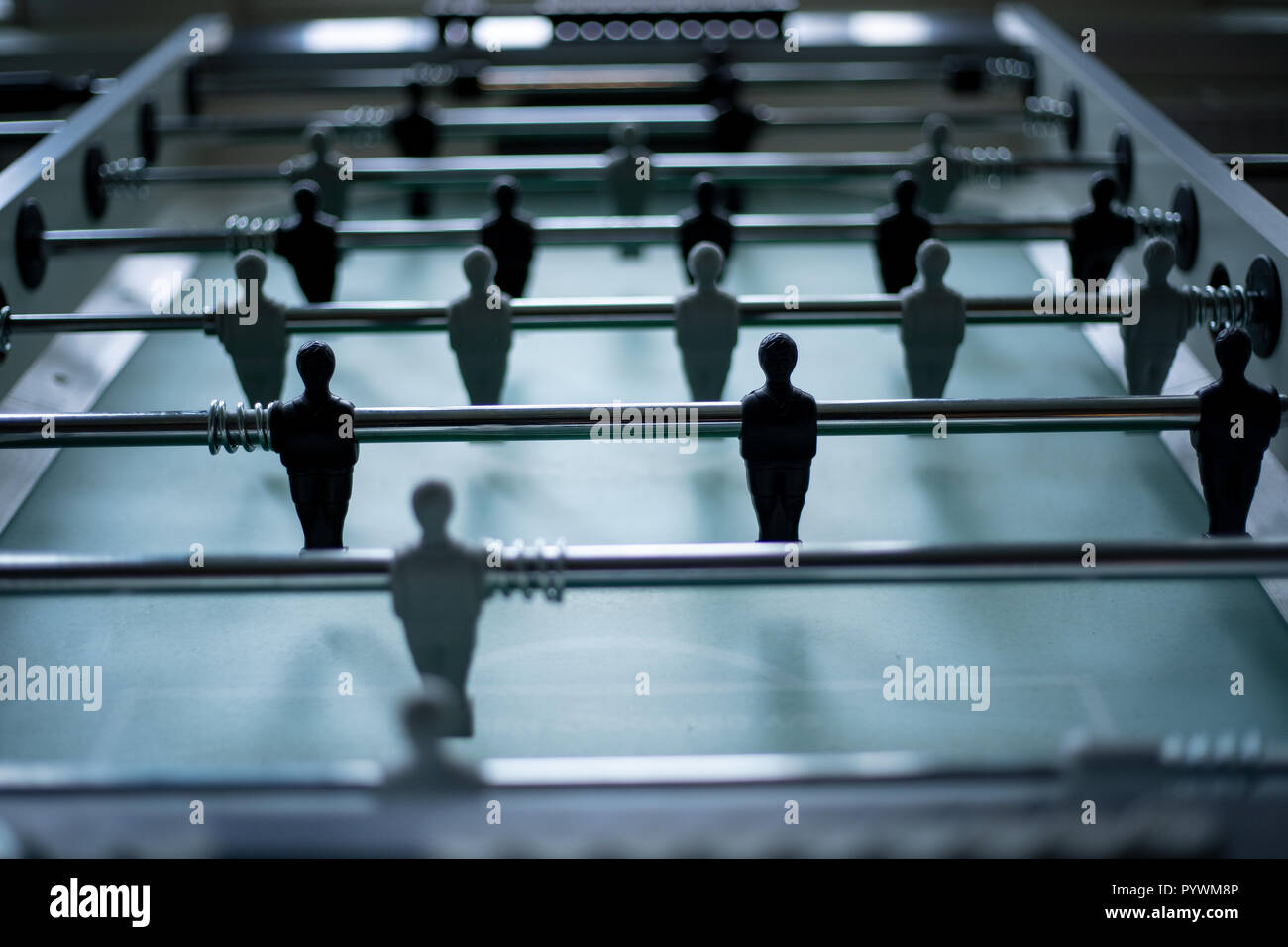 Table football table, football players close up black and white - Stock Image