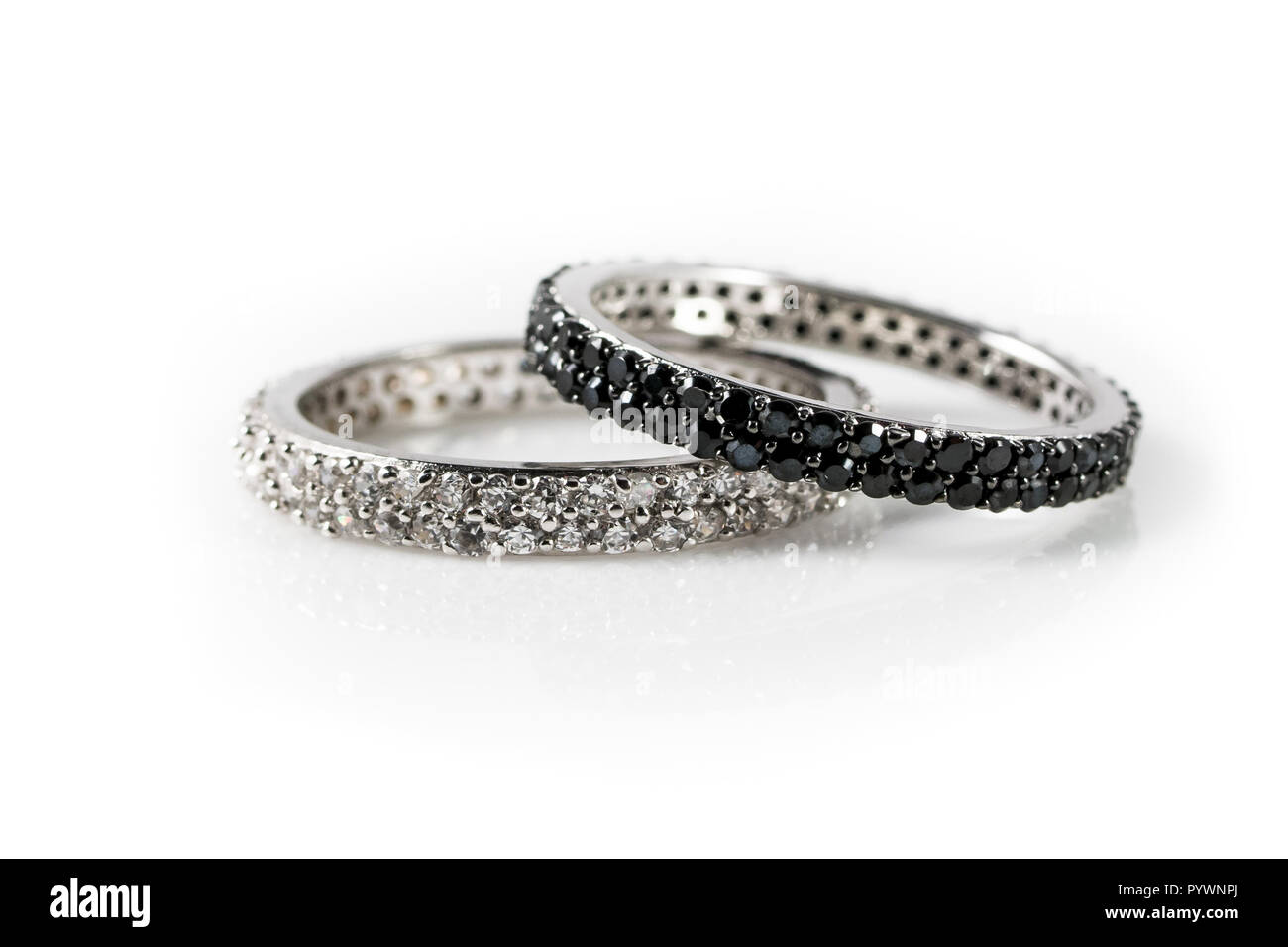 Black and white engagement rings as a symbol for a mixed races marriage - Stock Image