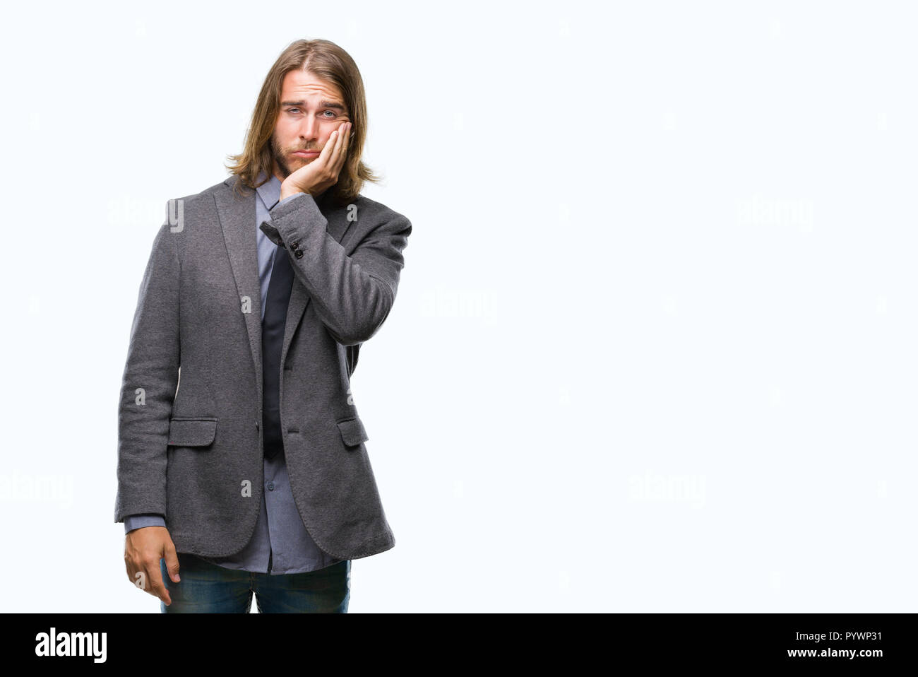 Young handsome business man with long hair over isolated background thinking looking tired and bored with depression problems with crossed arms. Stock Photo
