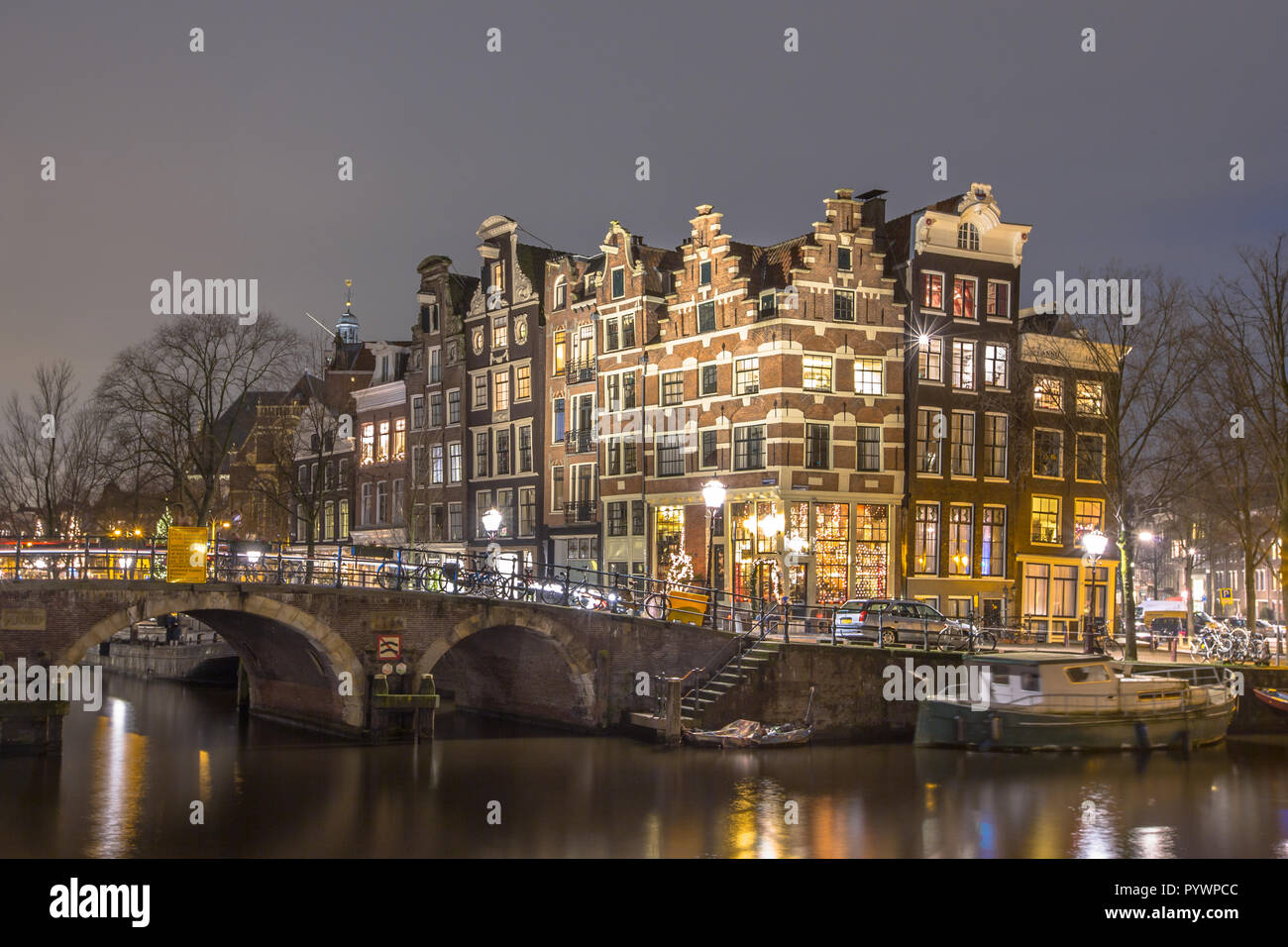 Nightscape of Colorful traditional canal houses on the corner of brouwersgracht and Prinsengracht in the UNESCO World Heritage site of Amsterdam - Stock Image