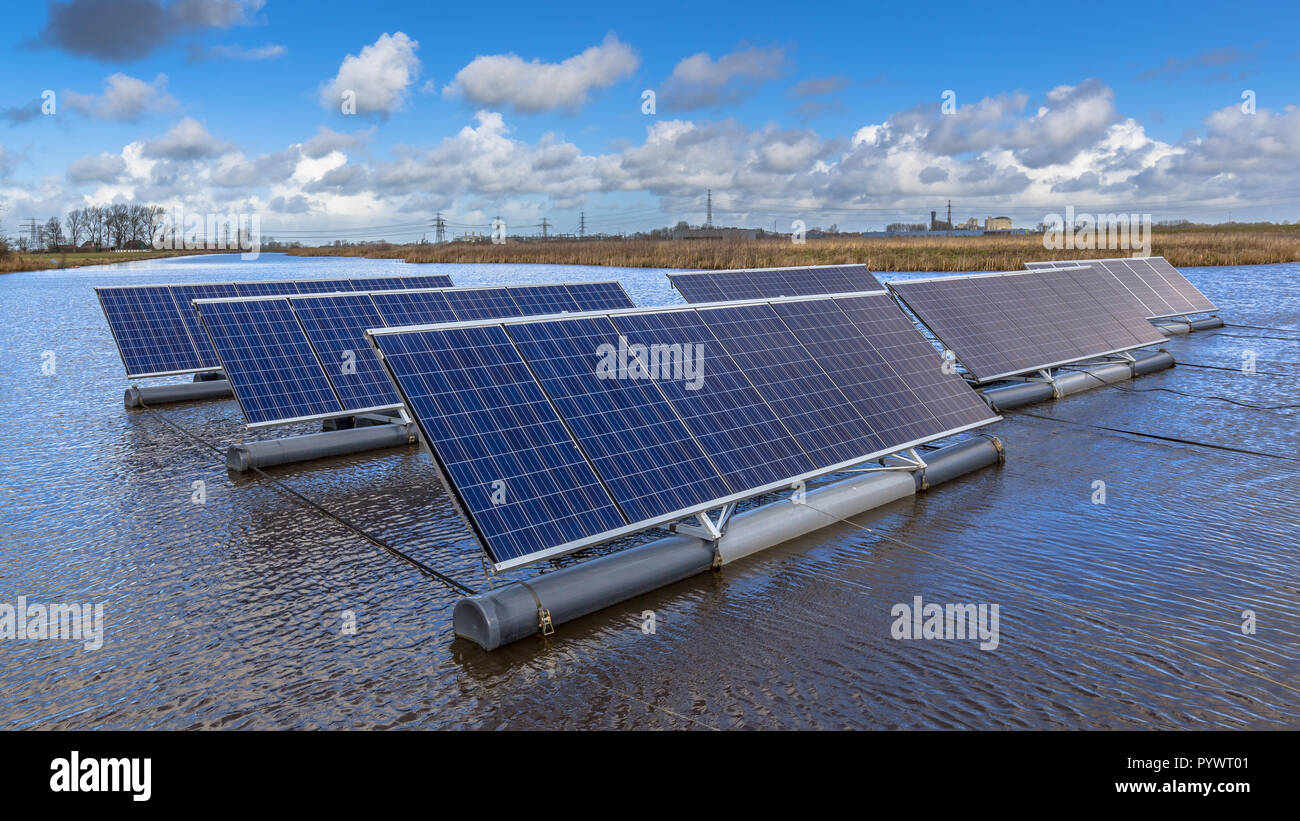 Close up of Group of photovoltaic panels floating on open water bodies can represent a serious alternative to ground mounted solar systems - Stock Image