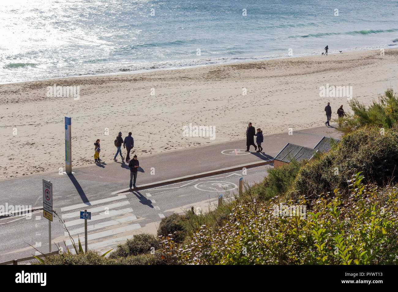 Sunday afternoon on Bournemouth beach with people enjoying some autumnal sunshine on a chilly day, October 2018, Dorset, UK - Stock Image