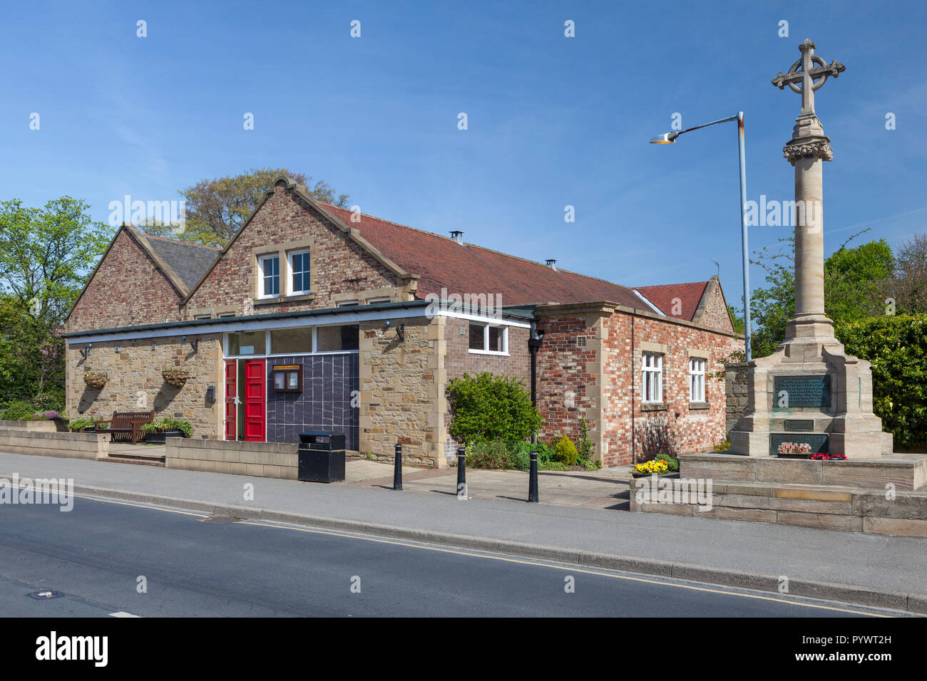 The village hall and war memorial in Boston Spa, West Yorkshire - Stock Image