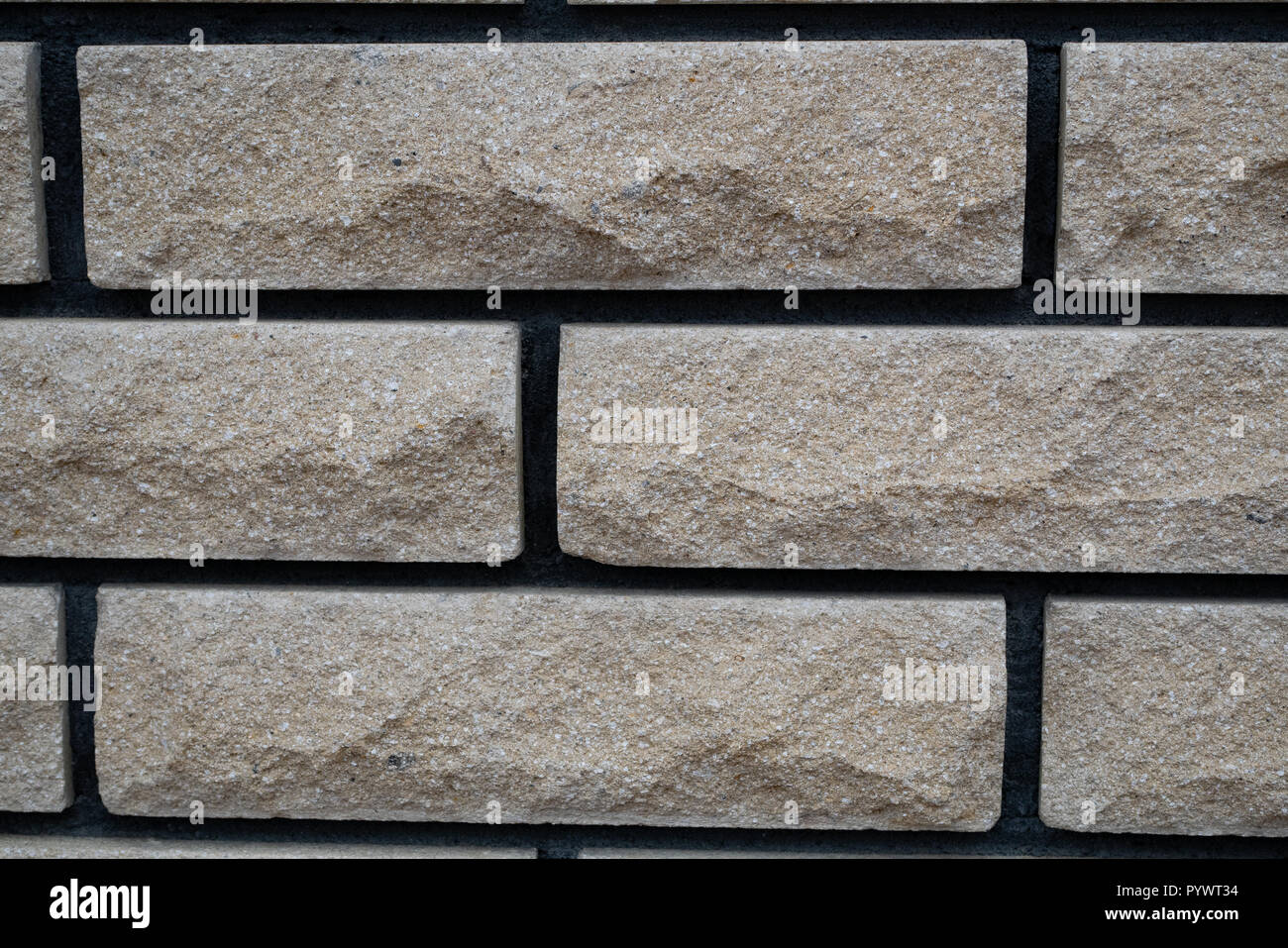 close up wall made of accurate white stone bricks tiles with