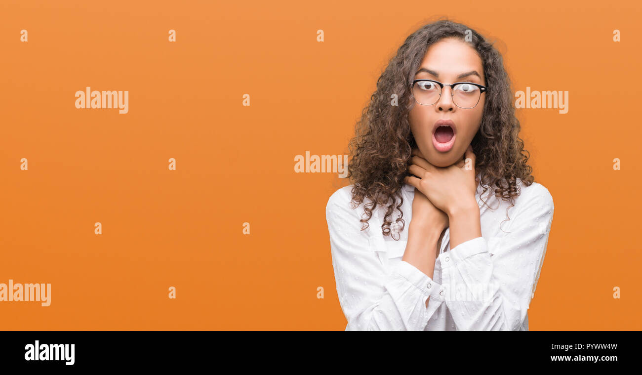 Beautiful young hispanic woman shouting and suffocate because painful strangle. Health problem. Asphyxiate and suicide concept. - Stock Image
