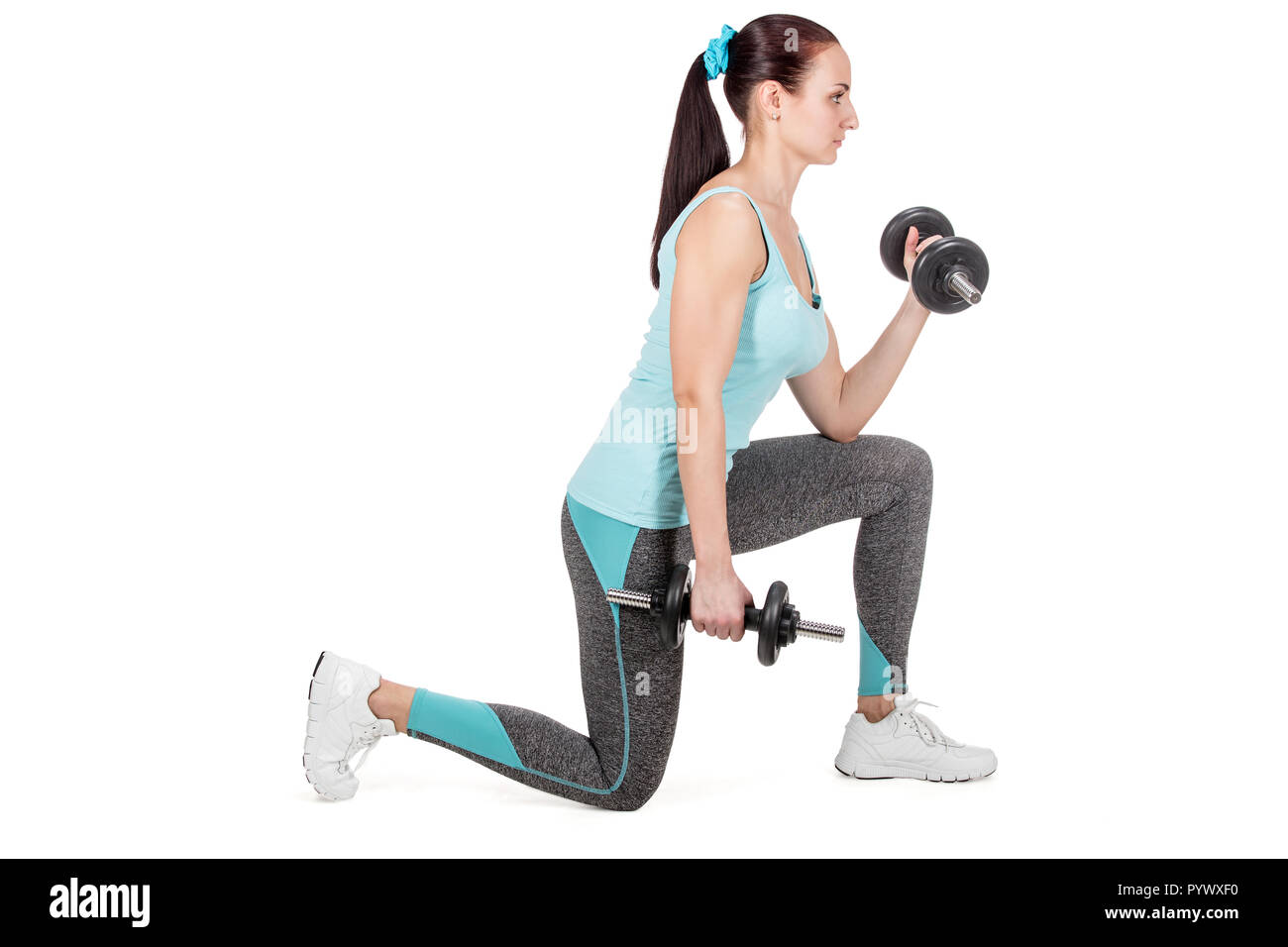 Fitness sports woman working out with dumbbells - Stock Image