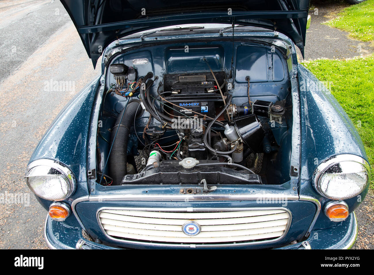 View inside the engine compartment of a Classic Morris Minor Traveller car - Stock Image