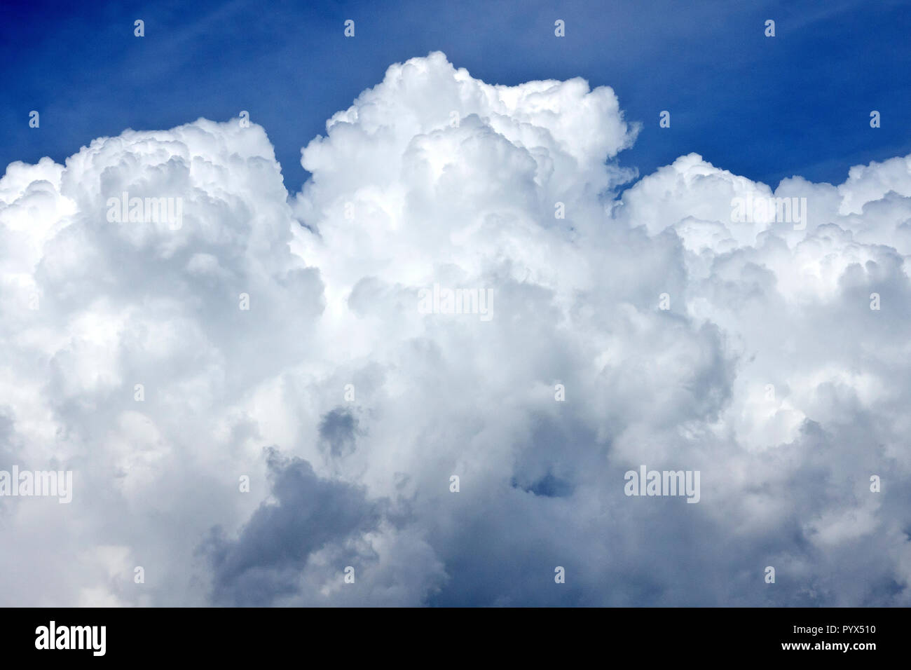 Approaching storm clouds (cumulonimbus) about to ruin a beautiful summer's day. - Stock Image
