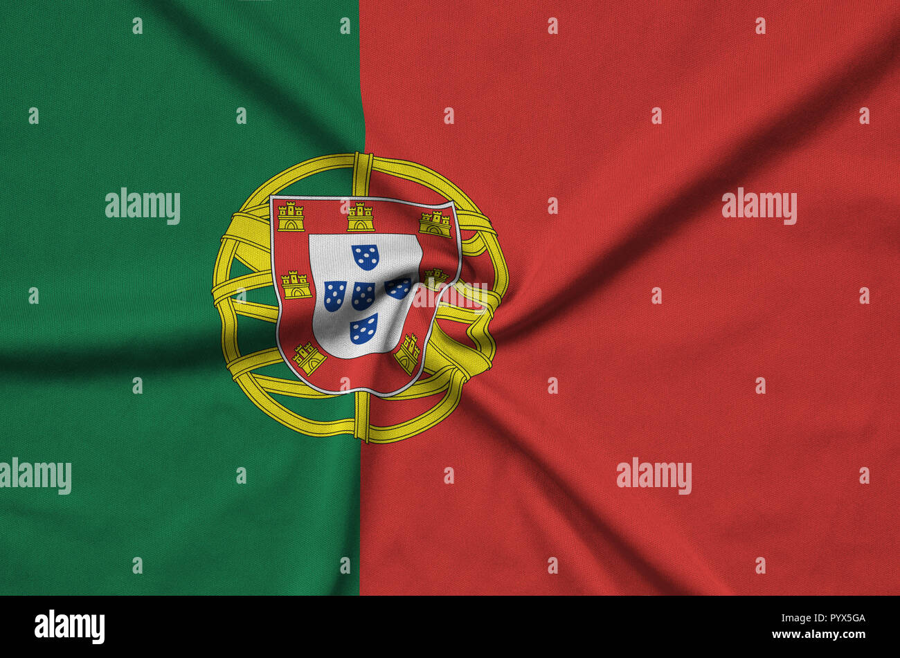 Portugal flag  is depicted on a sports cloth fabric with many folds. Sport team waving banner - Stock Image