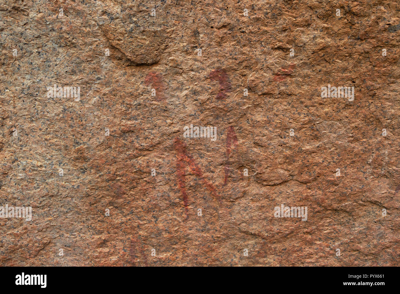 Namibia rock painting - ancient rock art by bushmen showing two men, or shamen, Small Bushman Paradise, Spitzkoppe, Namibia Africa - Stock Image