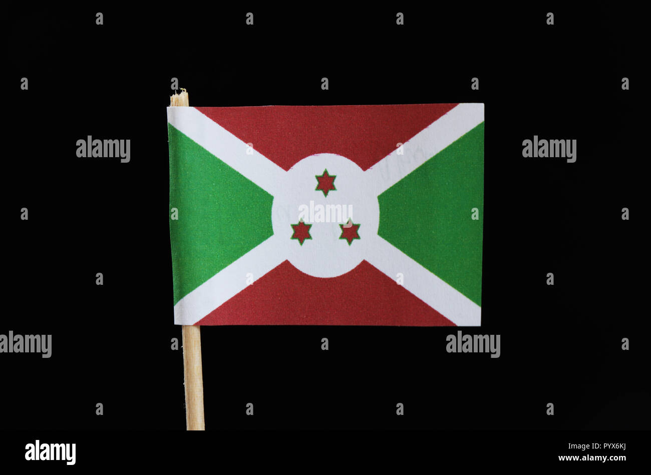 A Official Flag Of Burundi On Toothpick On Black Background