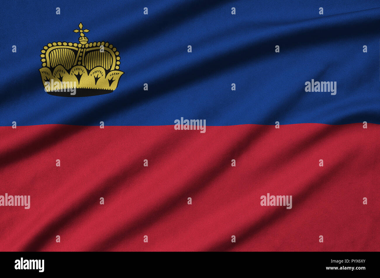 Liechtenstein flag  is depicted on a sports cloth fabric with many folds. Sport team waving banner Stock Photo