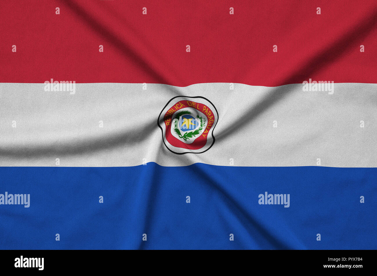 Paraguay flag  is depicted on a sports cloth fabric with many folds. Sport team waving banner Stock Photo