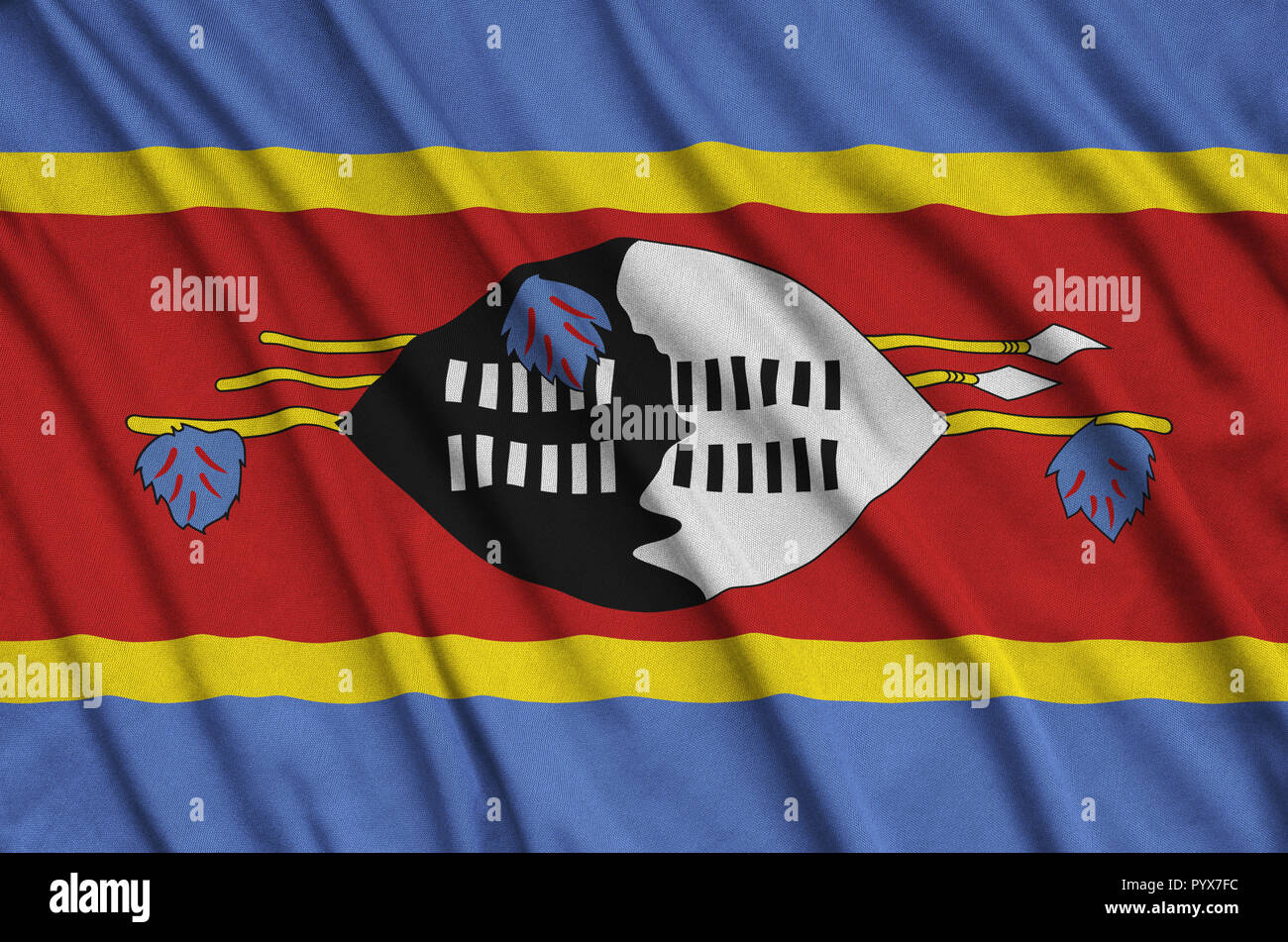 Swaziland flag  is depicted on a sports cloth fabric with many folds. Sport team waving banner Stock Photo