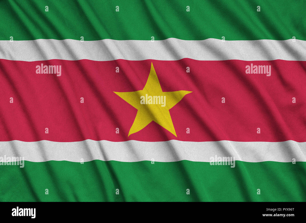 Suriname flag  is depicted on a sports cloth fabric with many folds. Sport team waving banner - Stock Image
