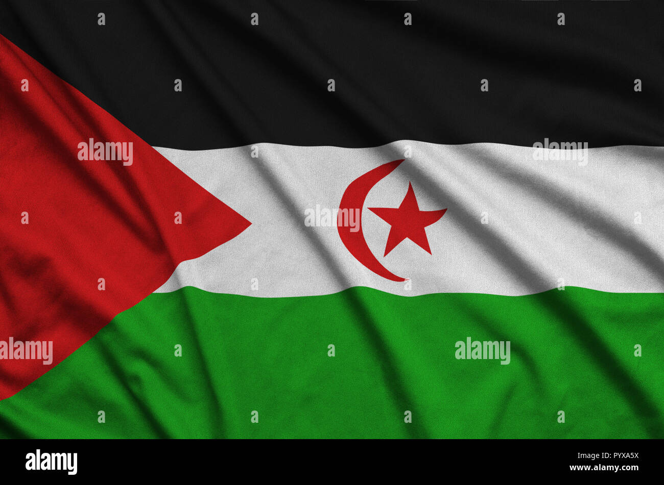 Western Sahara flag  is depicted on a sports cloth fabric with many folds. Sport team waving banner - Stock Image