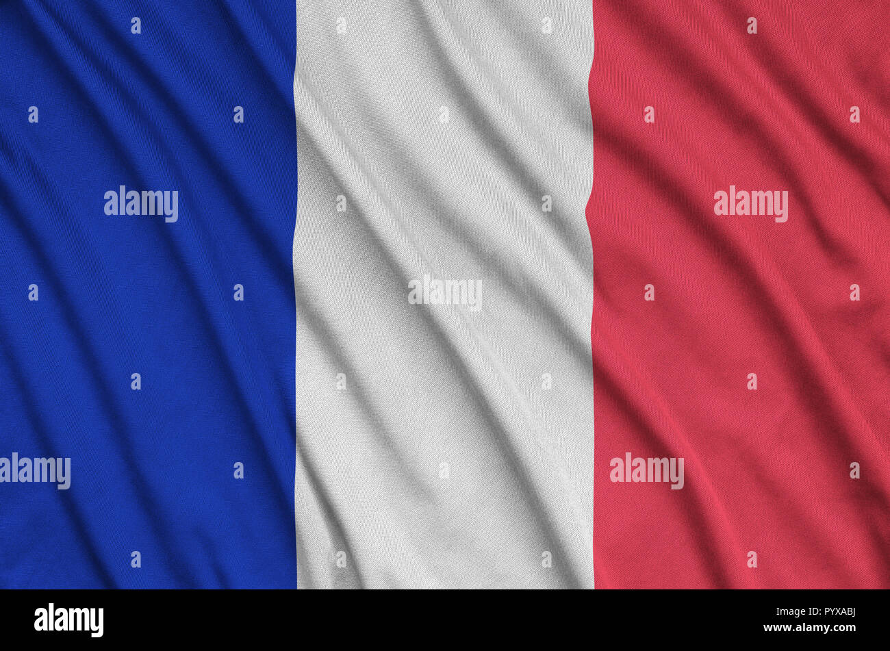 France flag  is depicted on a sports cloth fabric with many folds. Sport team waving banner - Stock Image