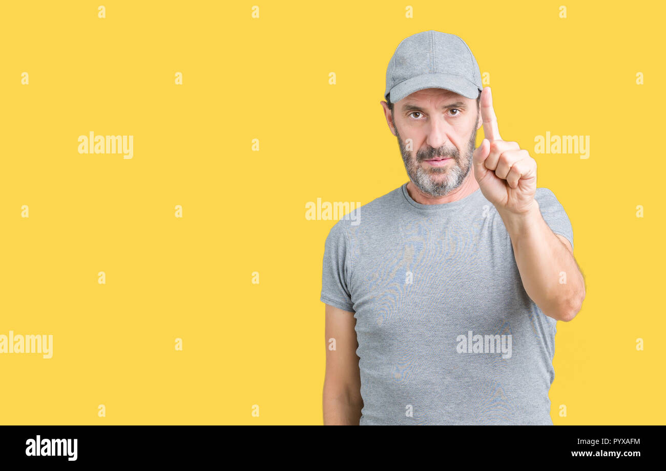 c79991c3a1821 Handsome middle age hoary senior man wearing sport cap over isolated  background Pointing with finger up