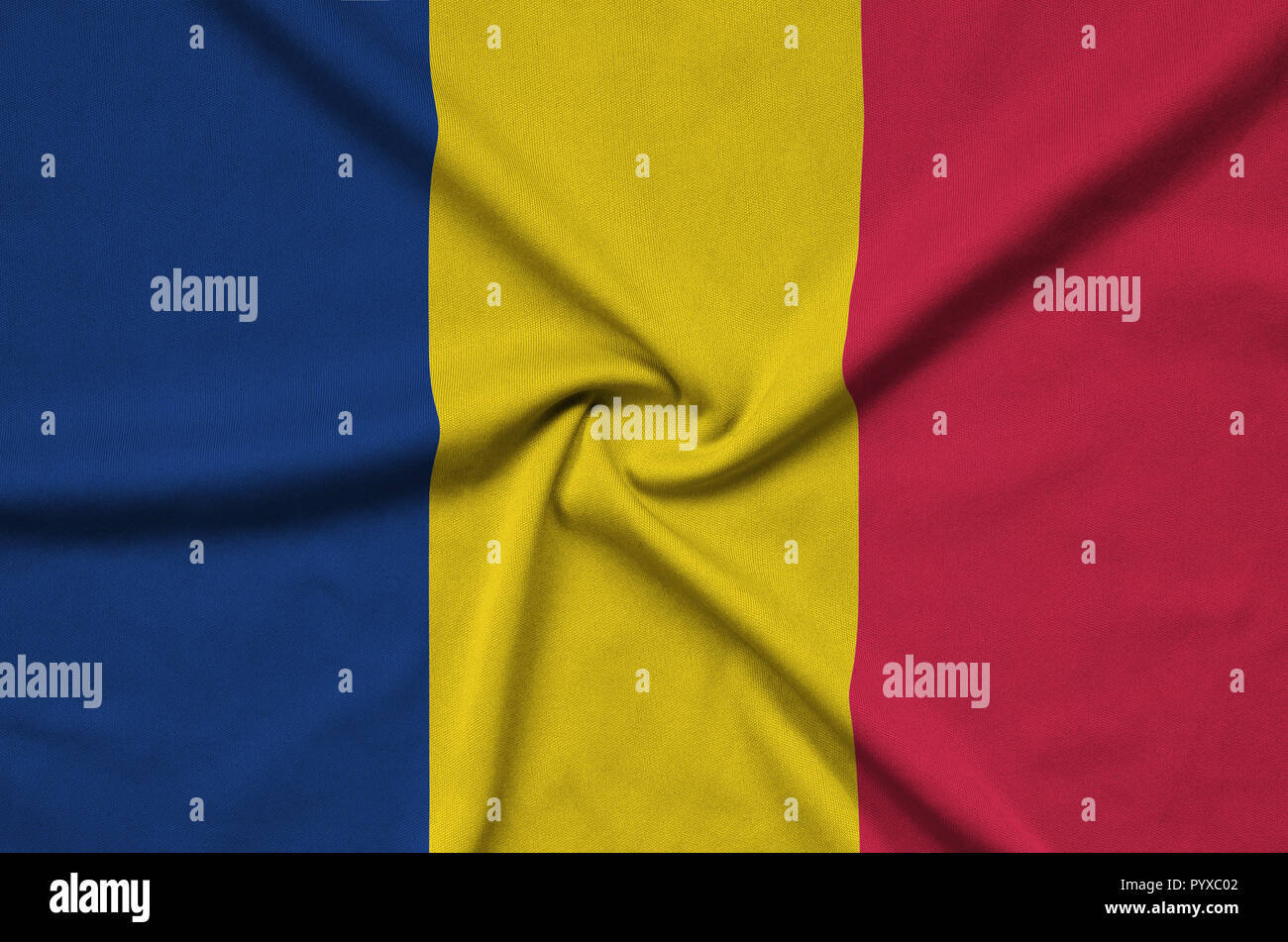 Chad flag  is depicted on a sports cloth fabric with many folds. Sport team waving banner - Stock Image