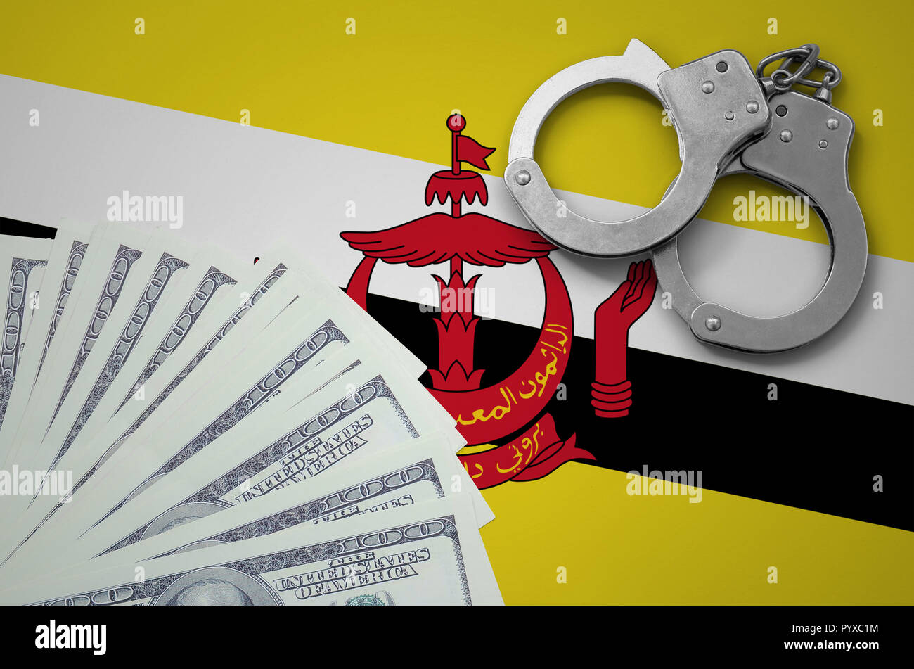Brunei Darussalam flag  with handcuffs and a bundle of dollars. The concept of illegal banking operations in US currency. - Stock Image