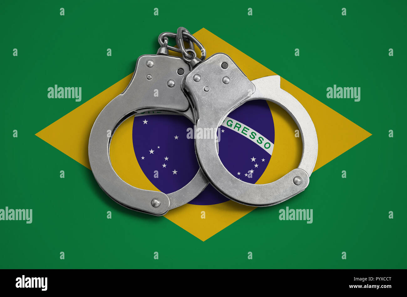 Brazil flag  and police handcuffs. The concept of observance of the law in the country and protection from crime. - Stock Image