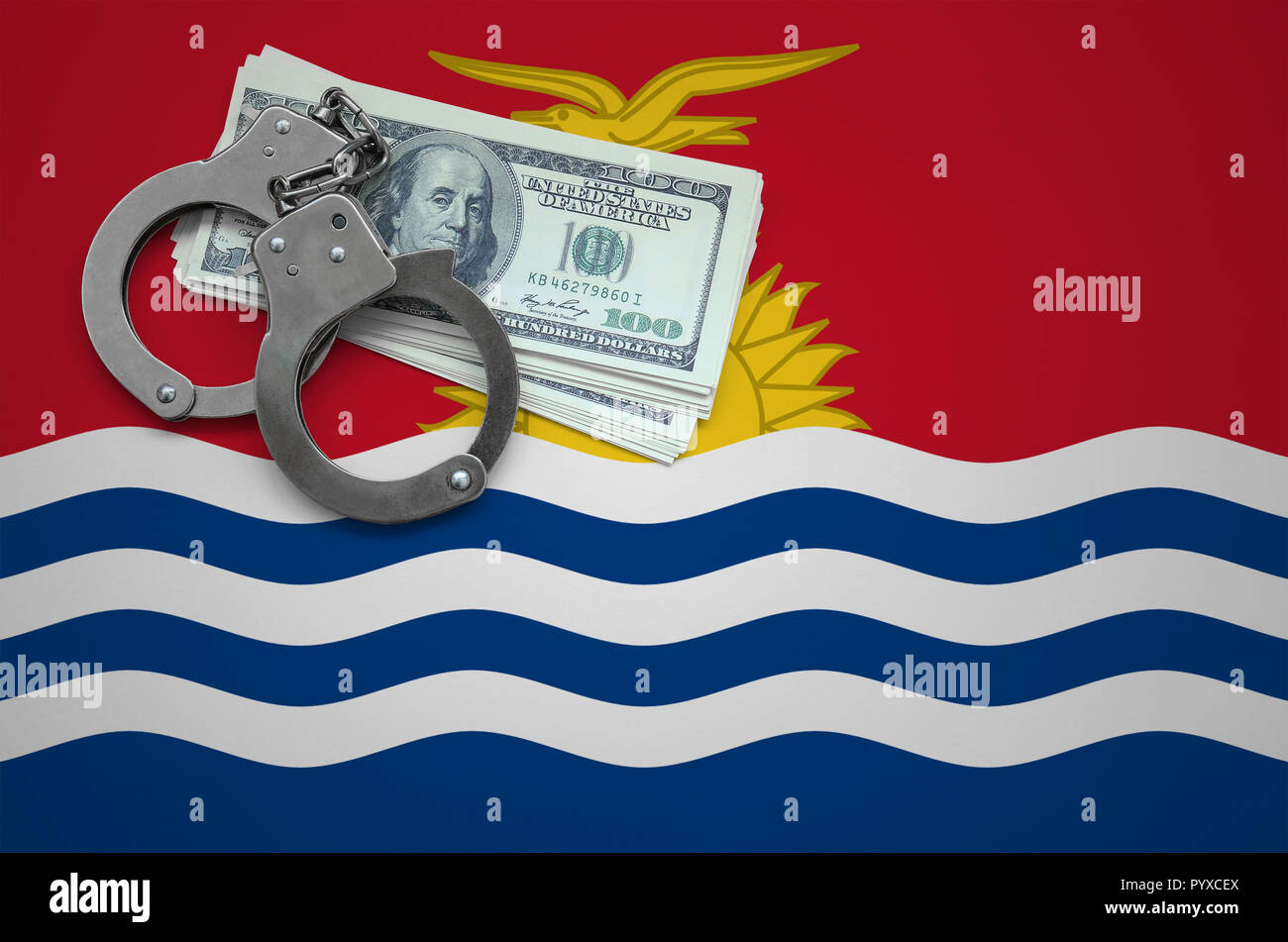 Kiribati flag  with handcuffs and a bundle of dollars. The concept of breaking the law and thieves crimes. - Stock Image