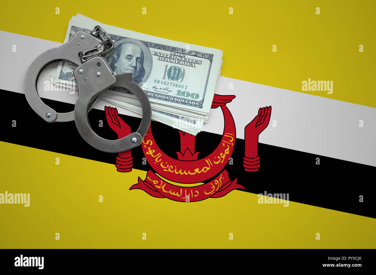 Brunei Darussalam flag  with handcuffs and a bundle of dollars. The concept of breaking the law and thieves crimes. - Stock Image