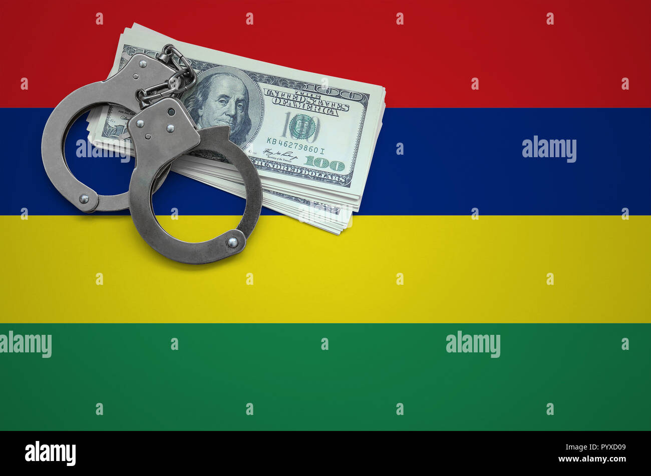 Mauritius flag  with handcuffs and a bundle of dollars. The concept of breaking the law and thieves crimes. - Stock Image