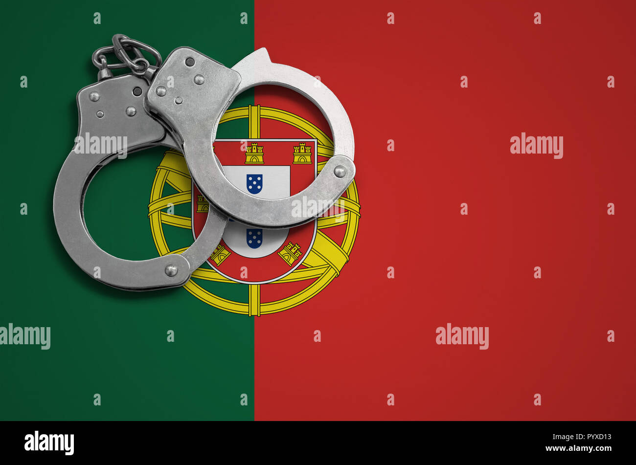 Portugal flag  and police handcuffs. The concept of crime and offenses in the country. - Stock Image