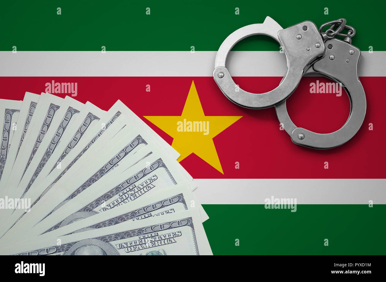 Suriname flag  with handcuffs and a bundle of dollars. The concept of illegal banking operations in US currency. - Stock Image