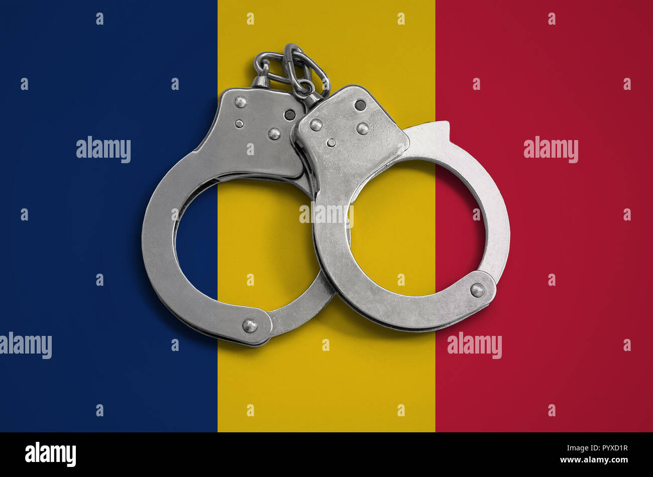 Chad flag  and police handcuffs. The concept of observance of the law in the country and protection from crime. - Stock Image