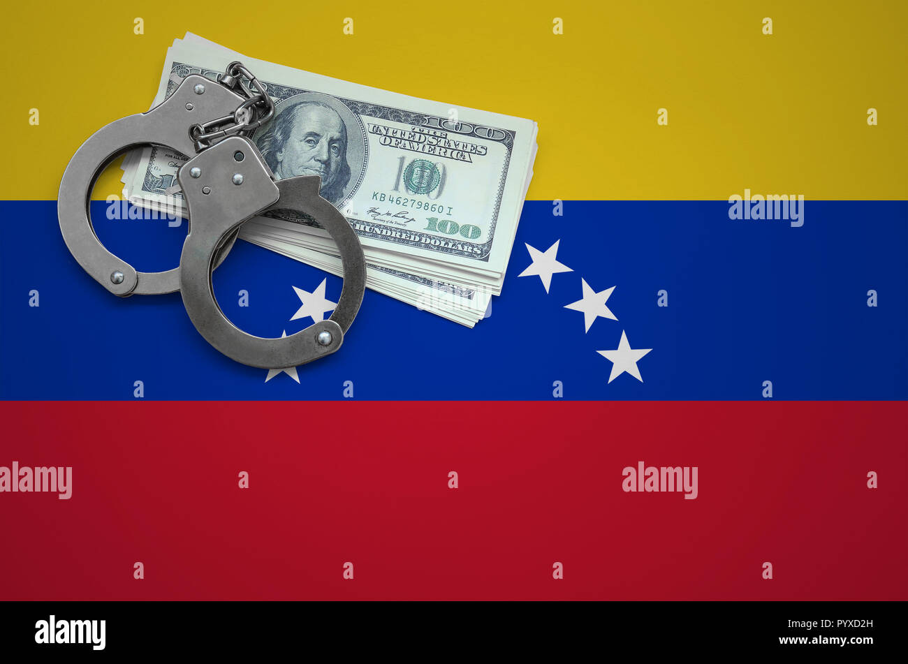 Venezuela flag  with handcuffs and a bundle of dollars. The concept of breaking the law and thieves crimes. - Stock Image