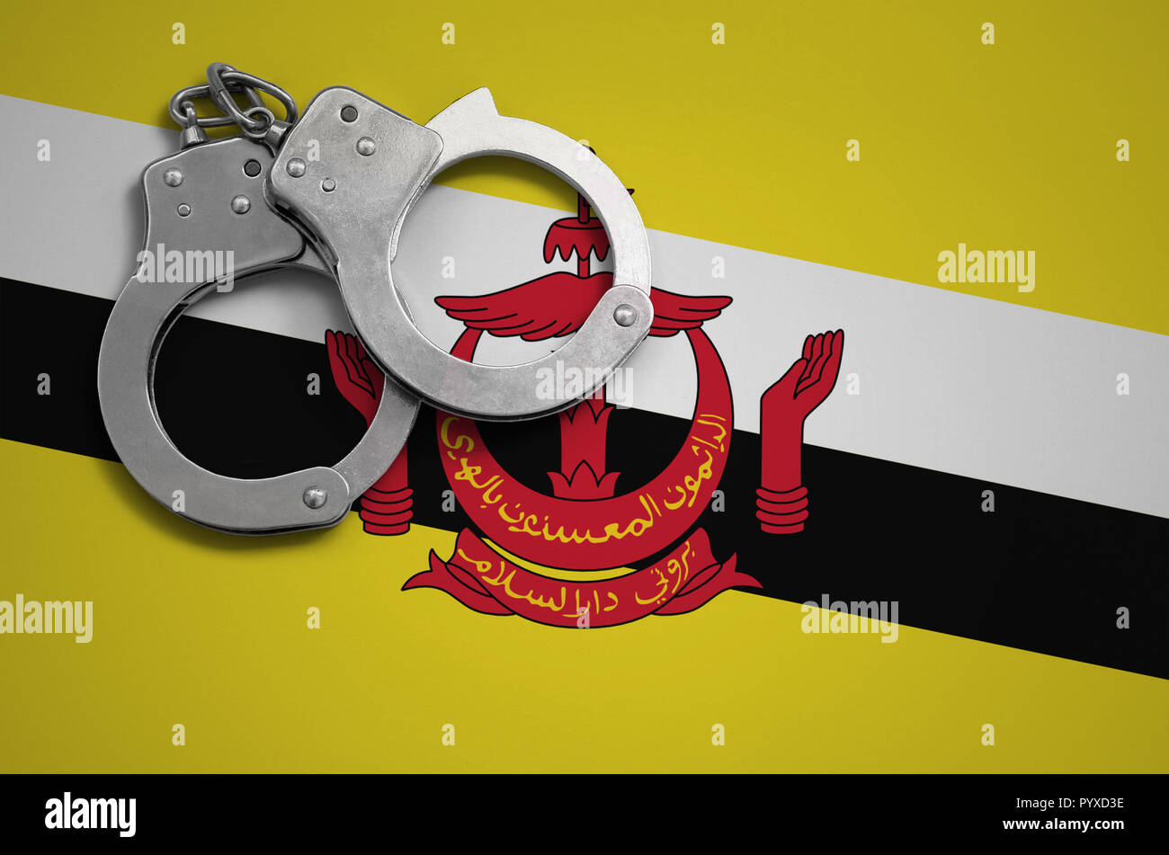 Brunei Darussalam flag  and police handcuffs. The concept of crime and offenses in the country. - Stock Image