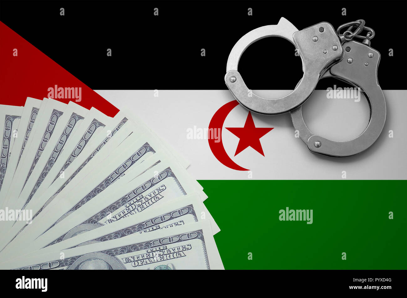 Western Sahara flag  with handcuffs and a bundle of dollars. The concept of illegal banking operations in US currency. - Stock Image
